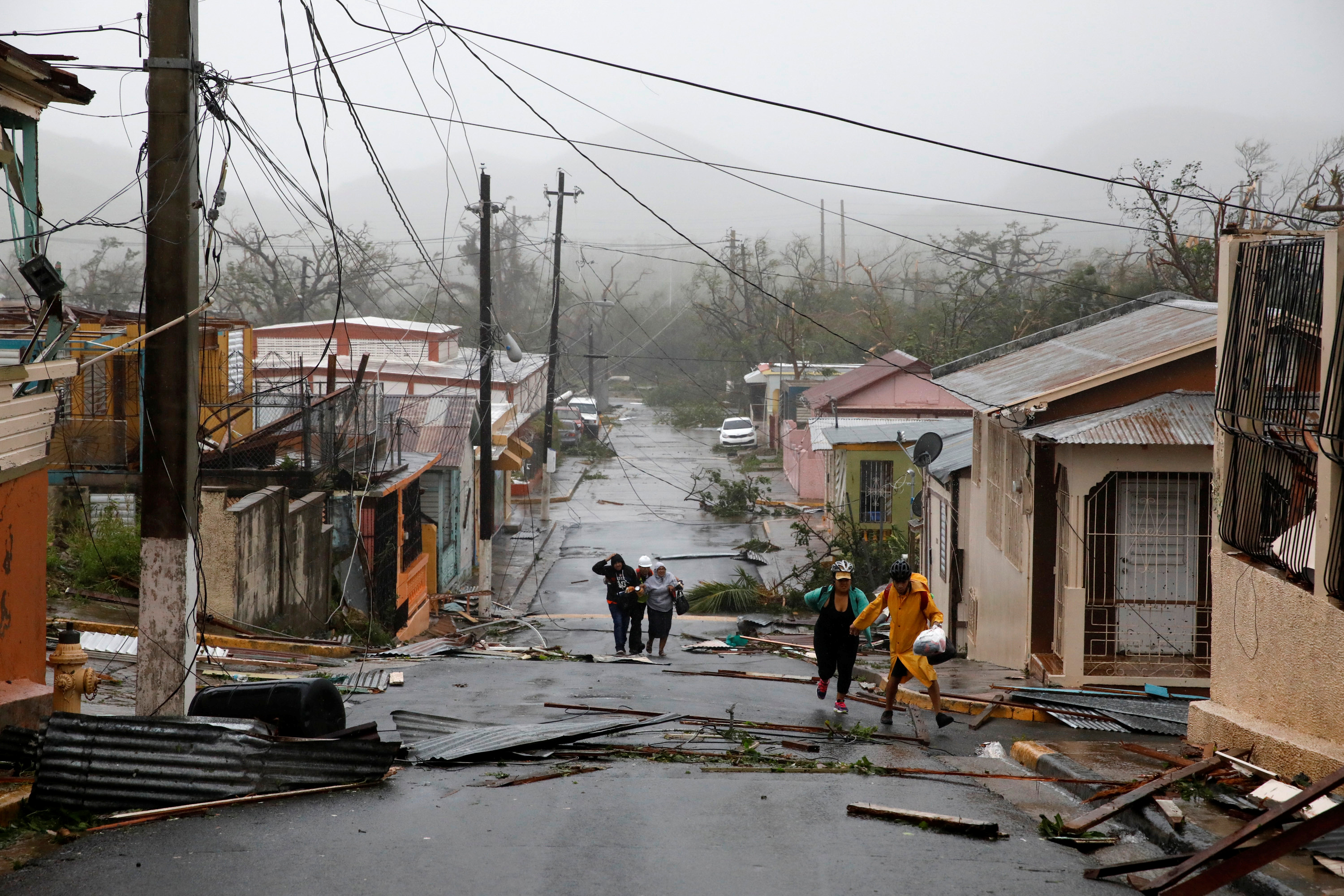 Rescue workers help people after the area was hit by Hurricane Maria in Guayama, Puerto Rico September 20, 2017. REUTERS/Carlos Garcia Rawlins