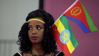 A woman wears the Ethiopian and Eritrean national flags during a concert at the Millennium Hall in Addis Ababa, Ethiopia July 15, 2018.