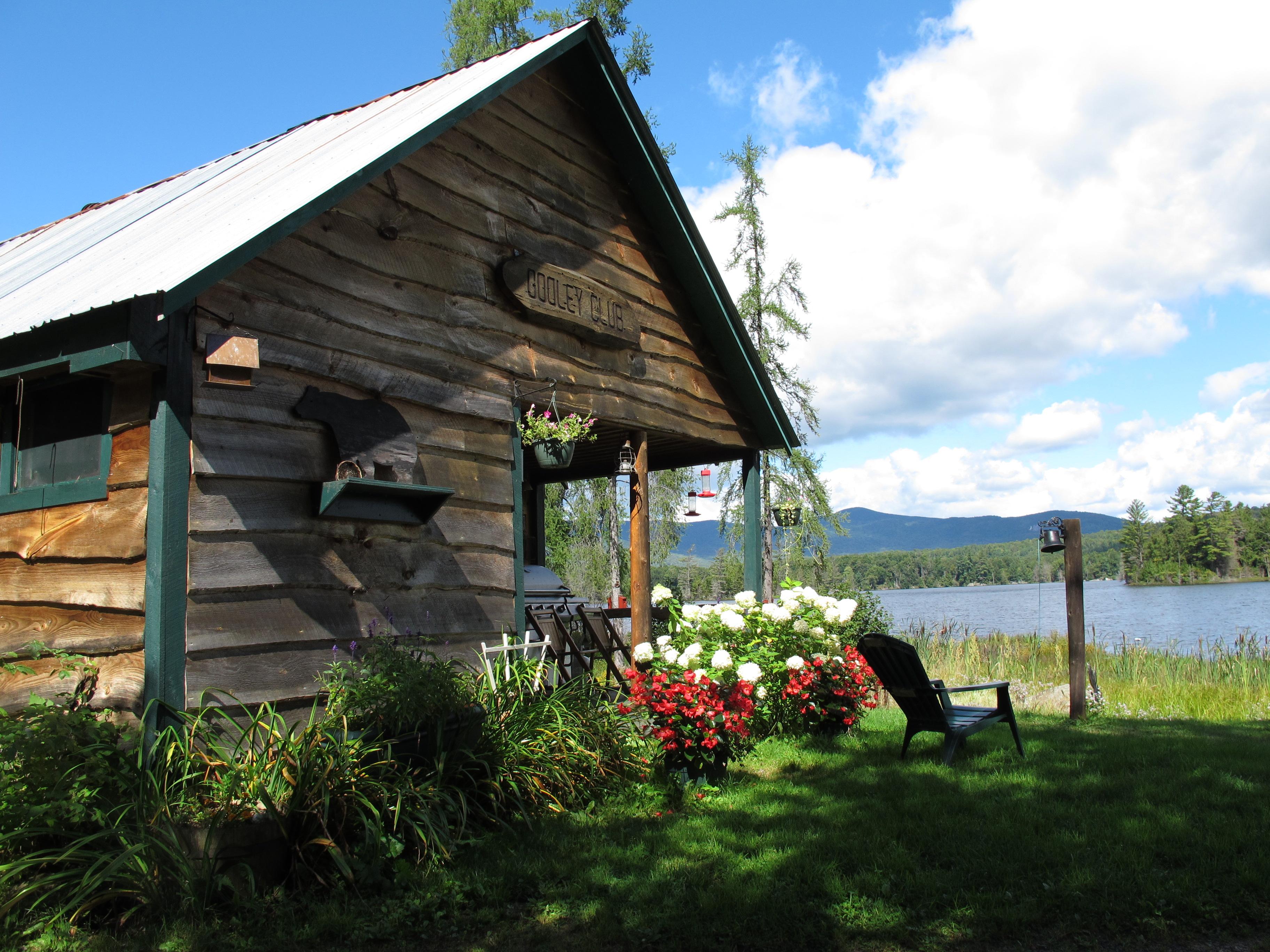 A cabin by a lake.