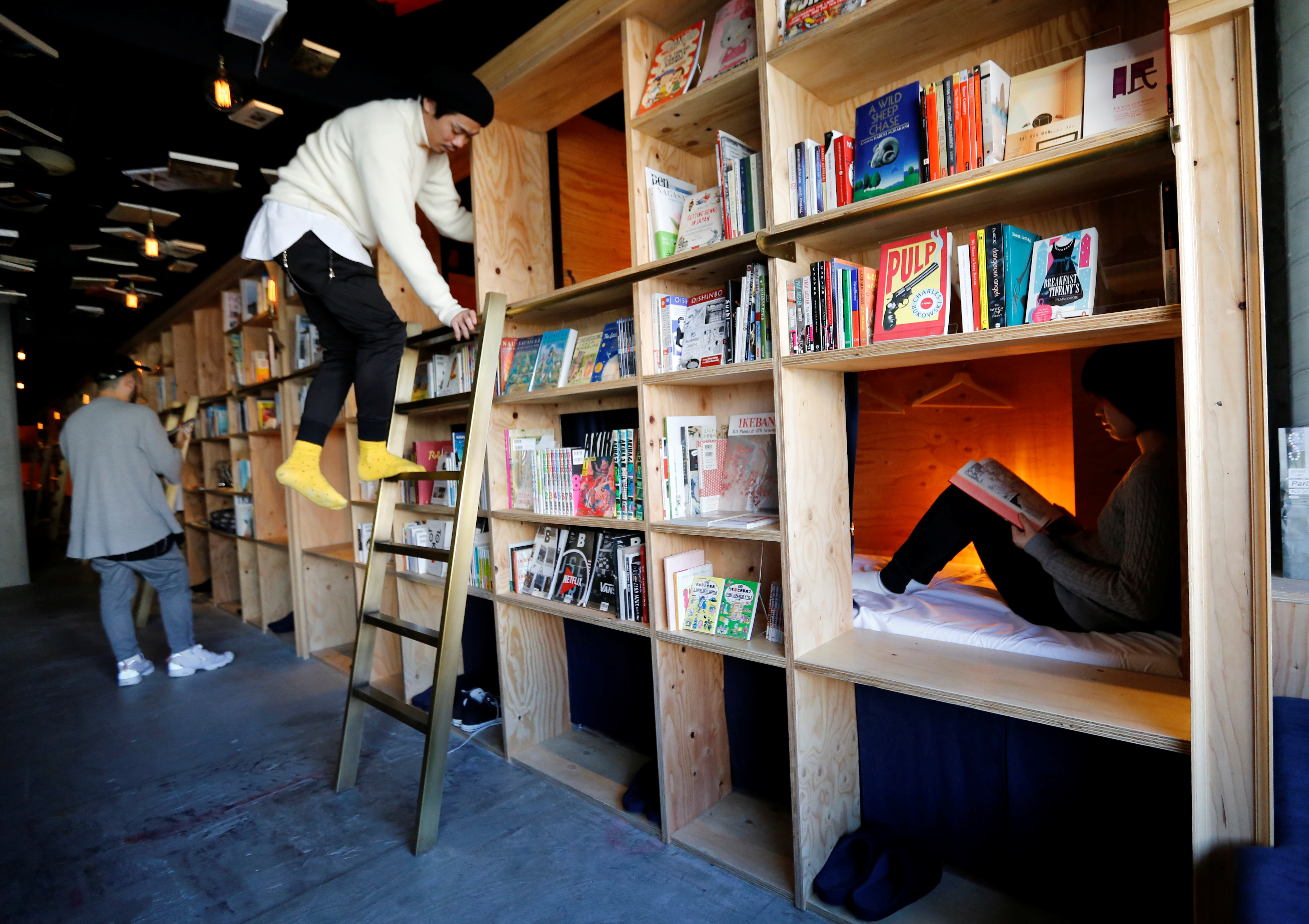 """Cabins are seen inside """"Book And Bed"""", a bookshop-themed capsule hotel, in Tokyo, Japan."""