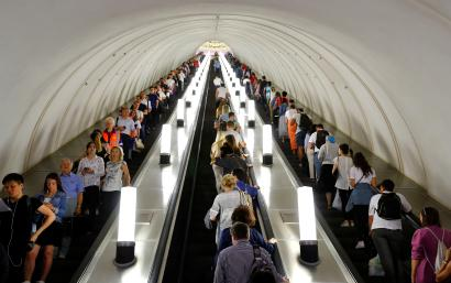 Commuters ride escalators at Park Kultury metro station in Moscow
