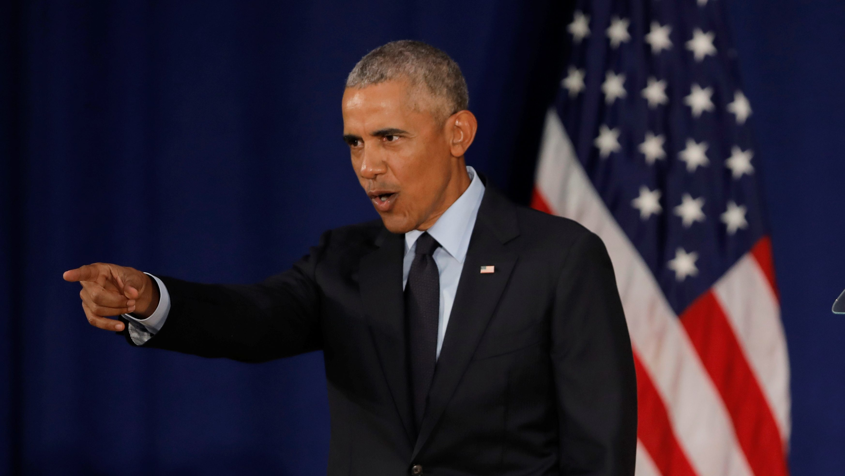 Former U.S. President Barack Obama leaves after speaking at the University of Illinois Urbana-Champaign.