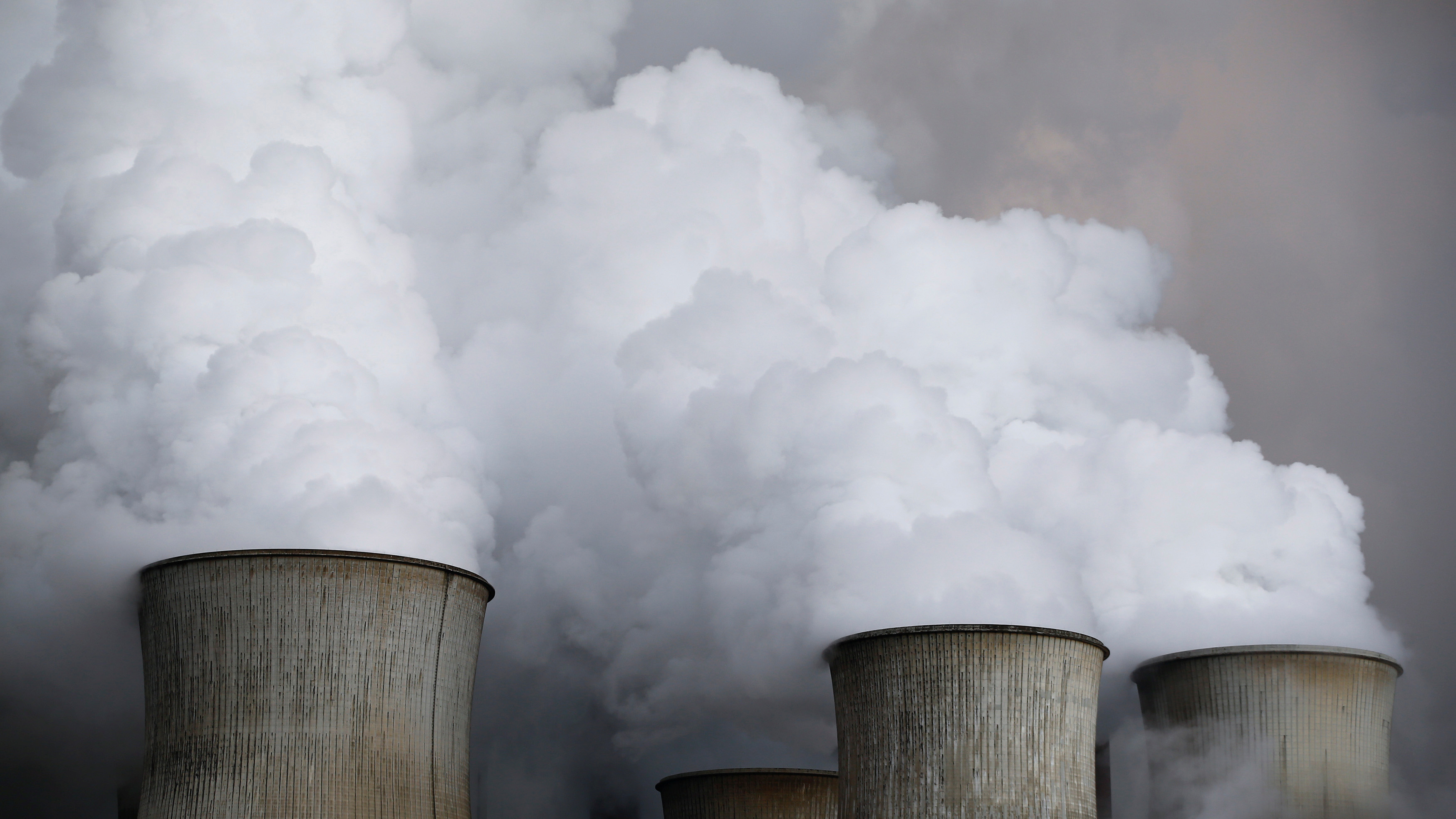 Steam rises from the cooling towers of the coal power plant of RWE, one of Europe's biggest electricity and gas companies in Niederaussem, north-west of Cologne, Germany. Picture taken March 3, 2016. REUTERS/Wolfgang Rattay/File Photo - RC1F95D28AD0