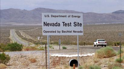 A car drives down a road leading into the Nevada Test Site which eventually could be used by trucks loaded with high-level radioactive waste Thursday, May 30, 1996, in Mercury, Nev. The U.S. Senate passed a bill Wednesday, July 31, 1996, that could make the Nevada Test Site an interim storage facility for radioactive waste.