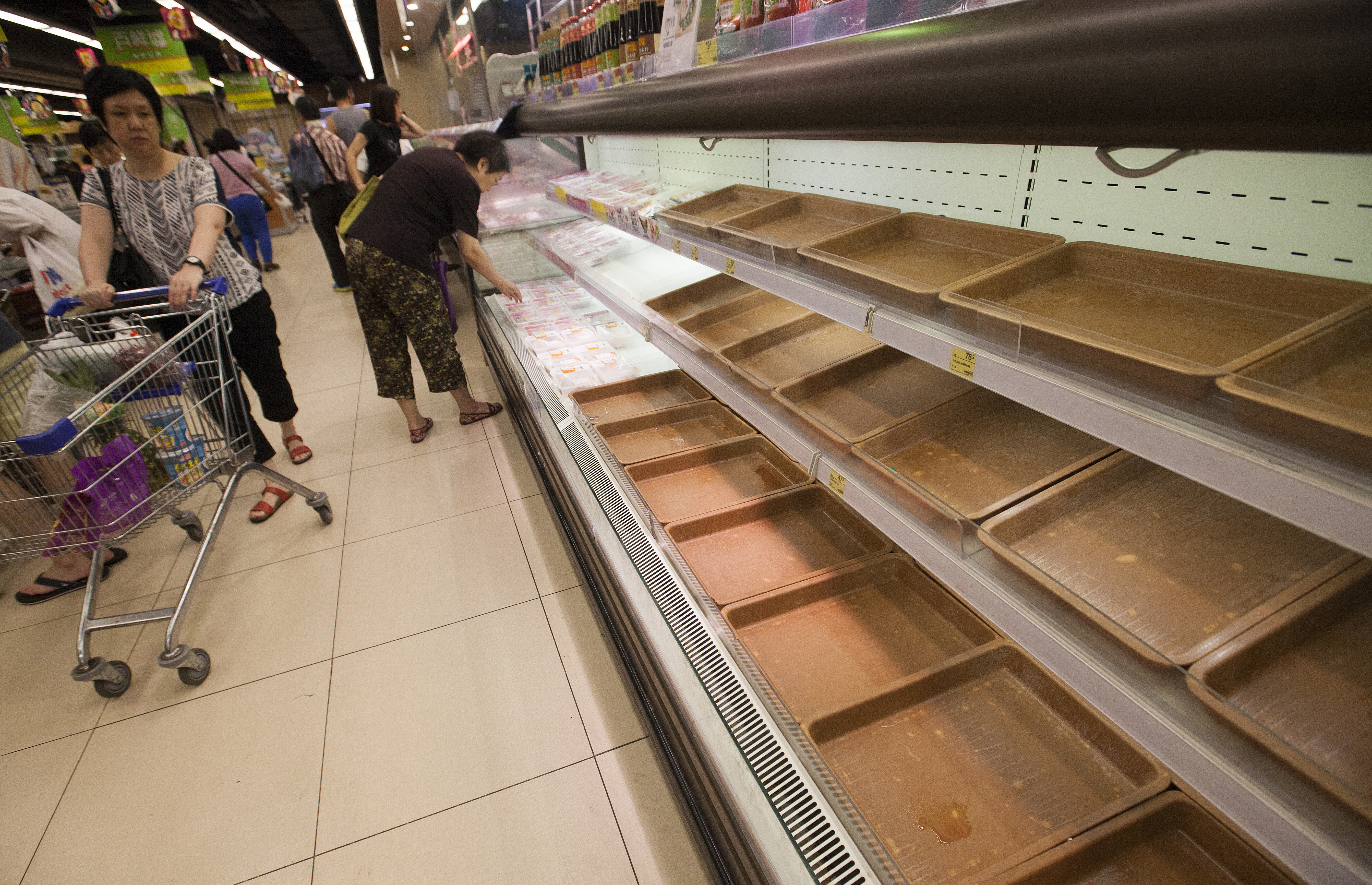 A supermarket shelf usually stocked with fish is stripped bare as people panic buy food supplies in preparation for the arrival of Super Typhoon Mangkhut, in a supermarket in Hang Hau, Tseung Kwan O, New Territories, Hong Kong, China, 15 September 2018. Experts say Super Typhoon Mangkhut will be the most powerful tropical storms to hit Hong Kong in decades.