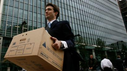 A worker carries a box out of the U.S. investment bank Lehman Brothers offices in the Canary Wharf district of London in this September 15, 2008 file photo.