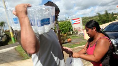 Municipal workers distribute water and ice provided by the U.S. Federal Emergency Management Agency (FEMA), after Hurricane Maria hit the island in September 2017