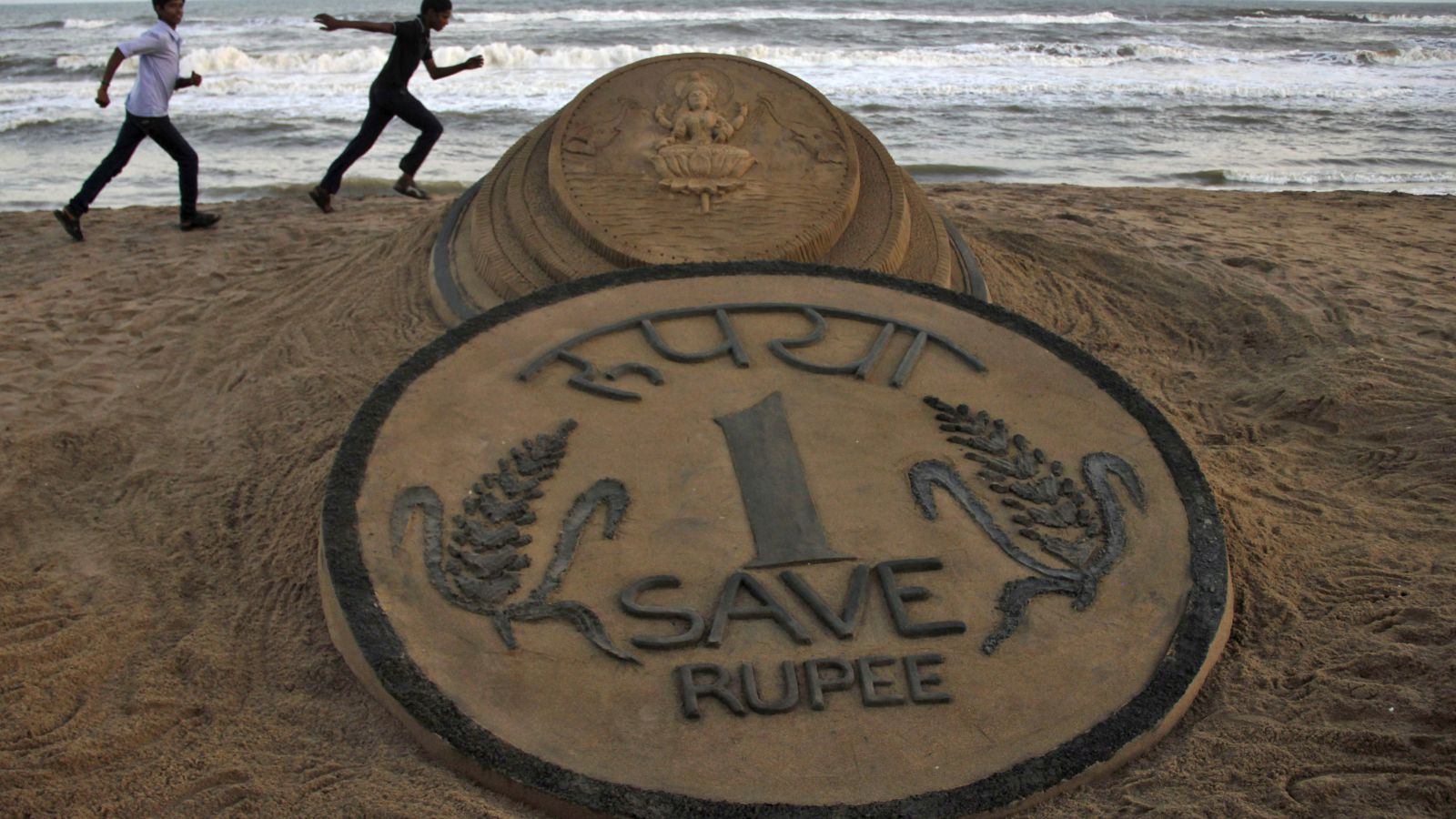 Why India's rupee is hurtling towards the 75 per dollar mark