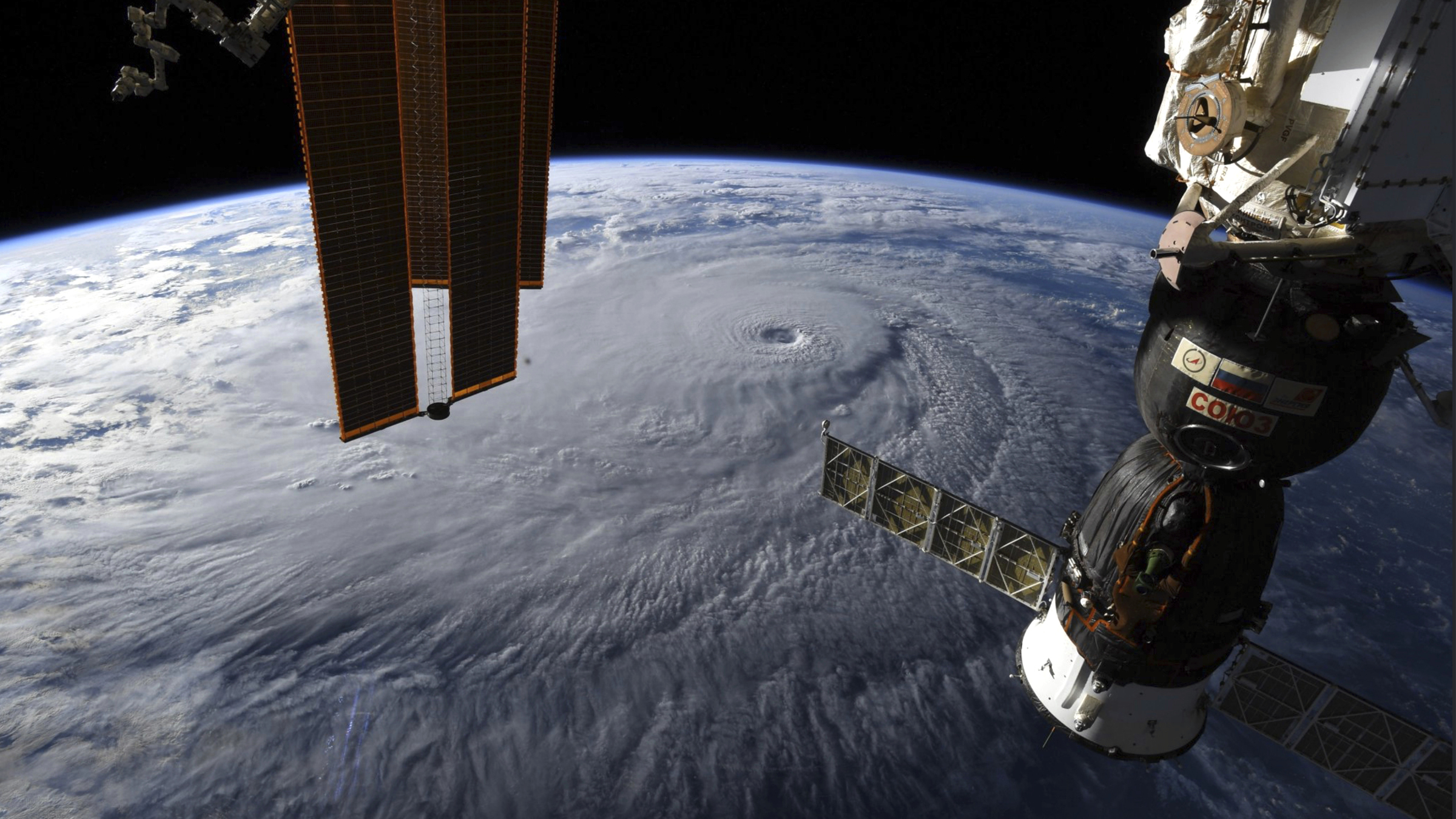 This image provided by NASA on Wednesday, Aug. 22, 2018 shows Hurricane Lane as seen from the International Space Station. The National Weather Service says the hurricane will still pack a wallop for Hawaii on Thursday before gradually slowing over the next two days. Early Wednesday, the hurricane was 320 miles (515 kilometers) south of Hilo on Hawaii Island and moving northwest toward other islands.