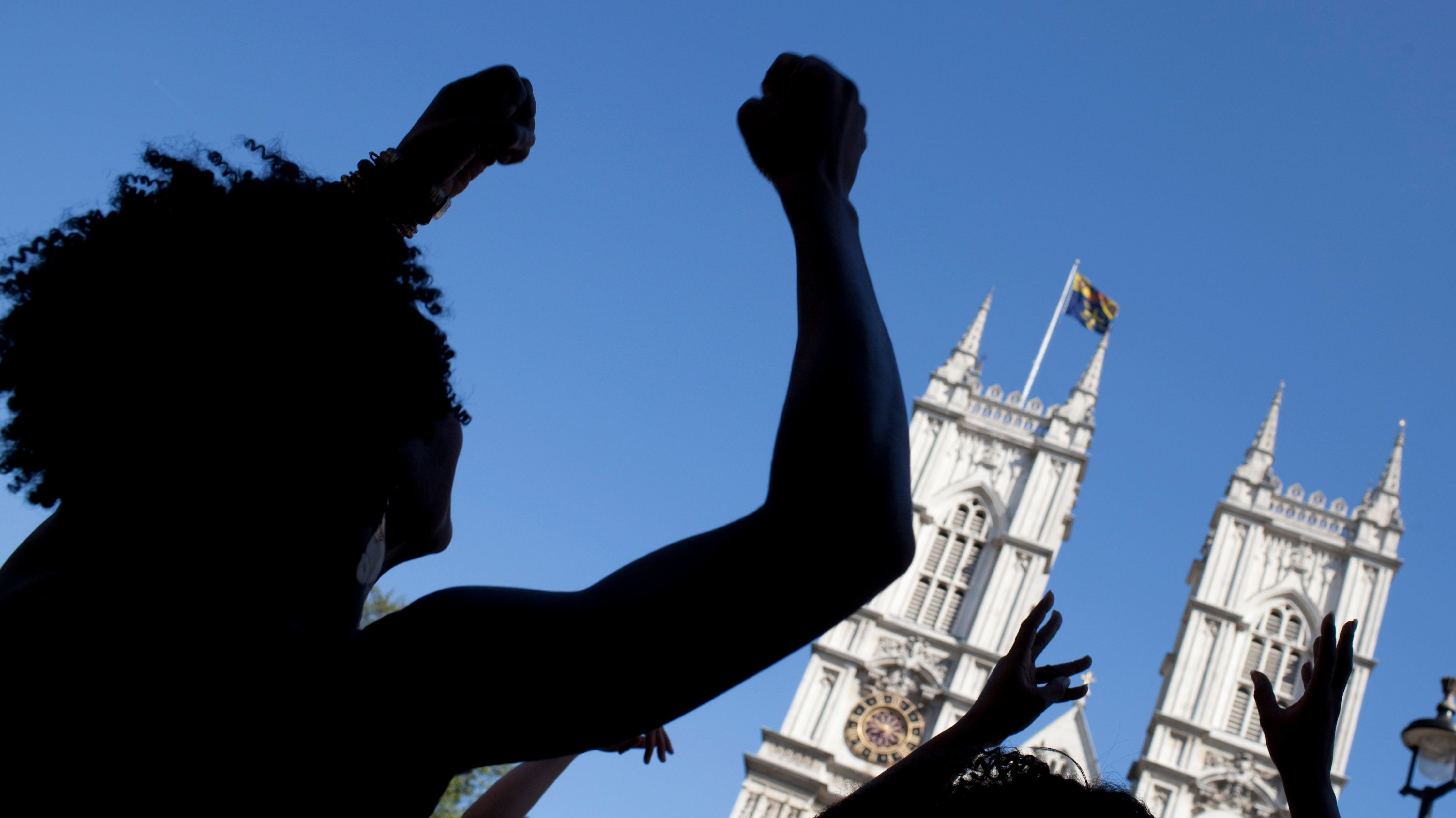 College students dance in front of Westminster Abbey in London. Olivette Otele this week became the first black woman professor of history in the UK.