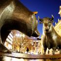 """In this Dec. 12, 2011 file photo the bull and bear bronze statue stands outside the stock market, Deutsche Boerse AG, in Frankfurt, Germany. Germany's Deutsche Boerse said Tuesday, March 20, 2012, it will sue the European Union's competition regulator over its decision to block the company's US dollar 10 billion merger with NYSE Euronext. Deutsche Boerse said it considers the decision by the European Commission to block the deal to be """"faulty"""" on several aspects and will take its complaint to a European court in Luxembourg."""