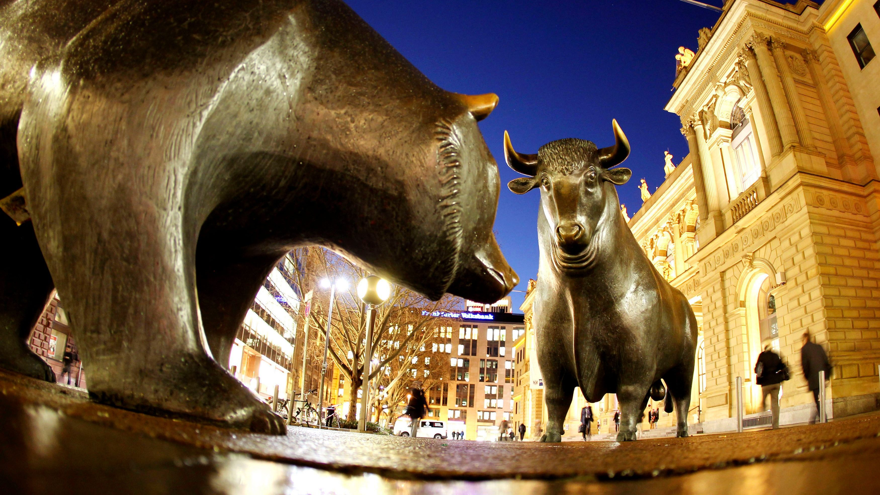 "In this Dec. 12, 2011 file photo the bull and bear bronze statue stands outside the stock market, Deutsche Boerse AG, in Frankfurt, Germany. Germany's Deutsche Boerse said Tuesday, March 20, 2012, it will sue the European Union's competition regulator over its decision to block the company's US dollar 10 billion merger with NYSE Euronext. Deutsche Boerse said it considers the decision by the European Commission to block the deal to be ""faulty"" on several aspects and will take its complaint to a European court in Luxembourg."