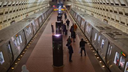 Passengers board subway trains at the Naval Yard-Ballpark Metro Station, Thursday, Feb. 8, 2018, part of the public transit network for Washington. (AP Photo/Pablo Martinez Monsivais)