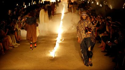 Models wear creations for Gucci's Cruise 2019 fashion collection at the ancient site of Alyscamps in Arles, southern France, Wednesday, May 30, 2018. (AP Photo/Claude Paris)