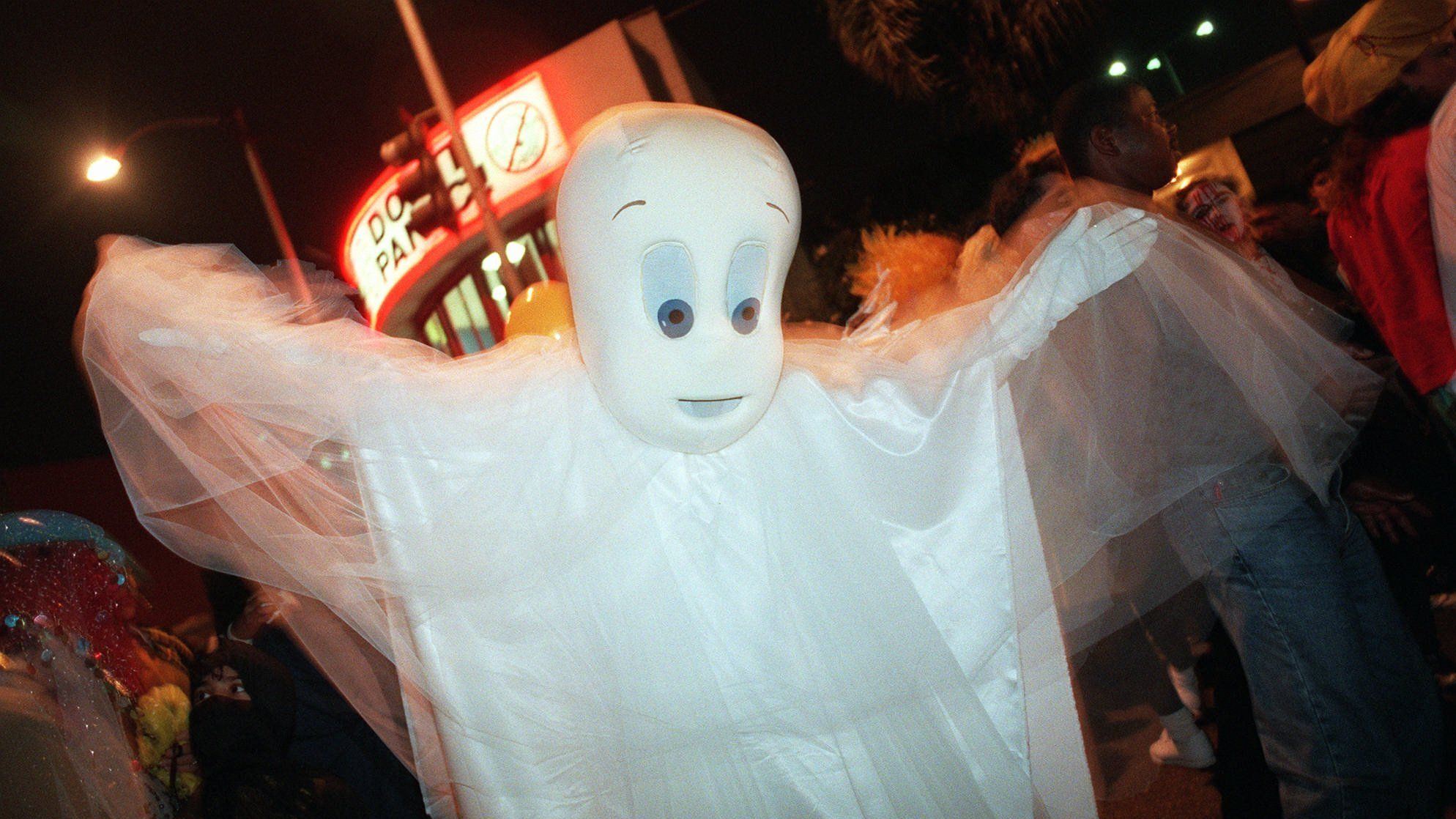 An unidentified Halloween reveler dressed as Casper the Friendly Ghost parades down Santa Monica Boulevard in West Hollywood, Calif., Tuesday, Oct. 31, 1995, during the city's annual Halloween parade The street was closed as thousands of party goers and onlookers walked in and out of costume. (AP Photo/Rene Macura)