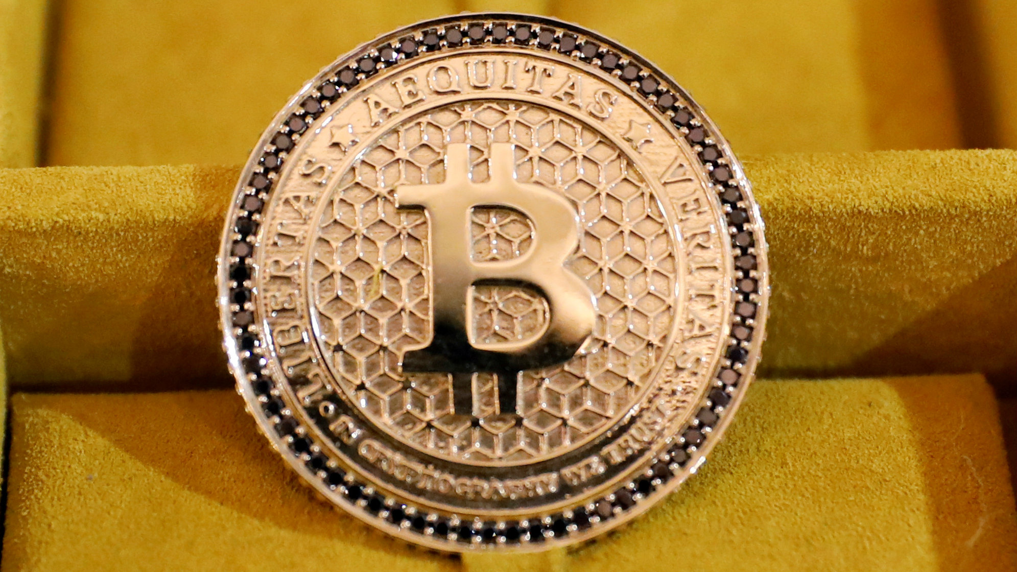 Jewelry with the Bitcoin logo on it