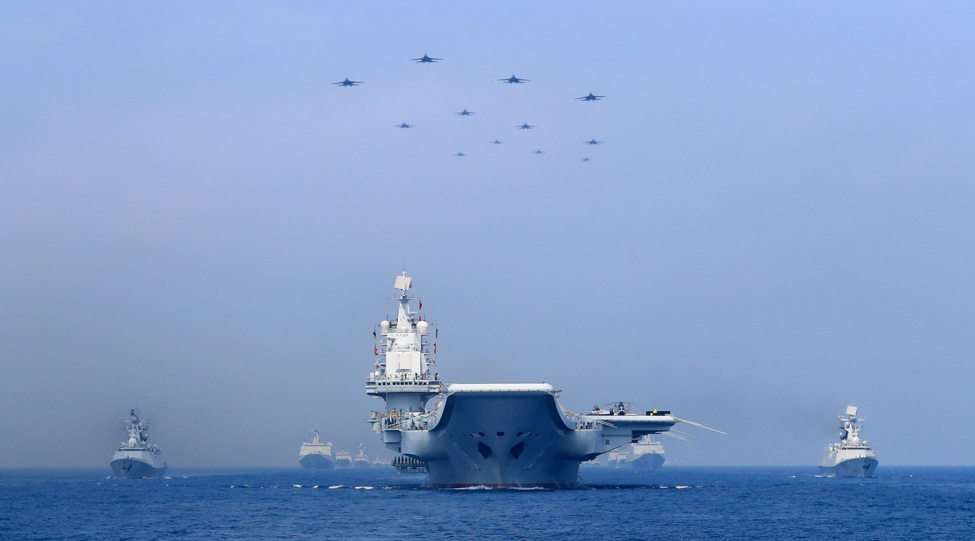 Warships and fighter jets of Chinese People's Liberation Army (PLA) Navy take part in a military display in the South China Sea April 12, 2018. Picture taken April 12, 2018.