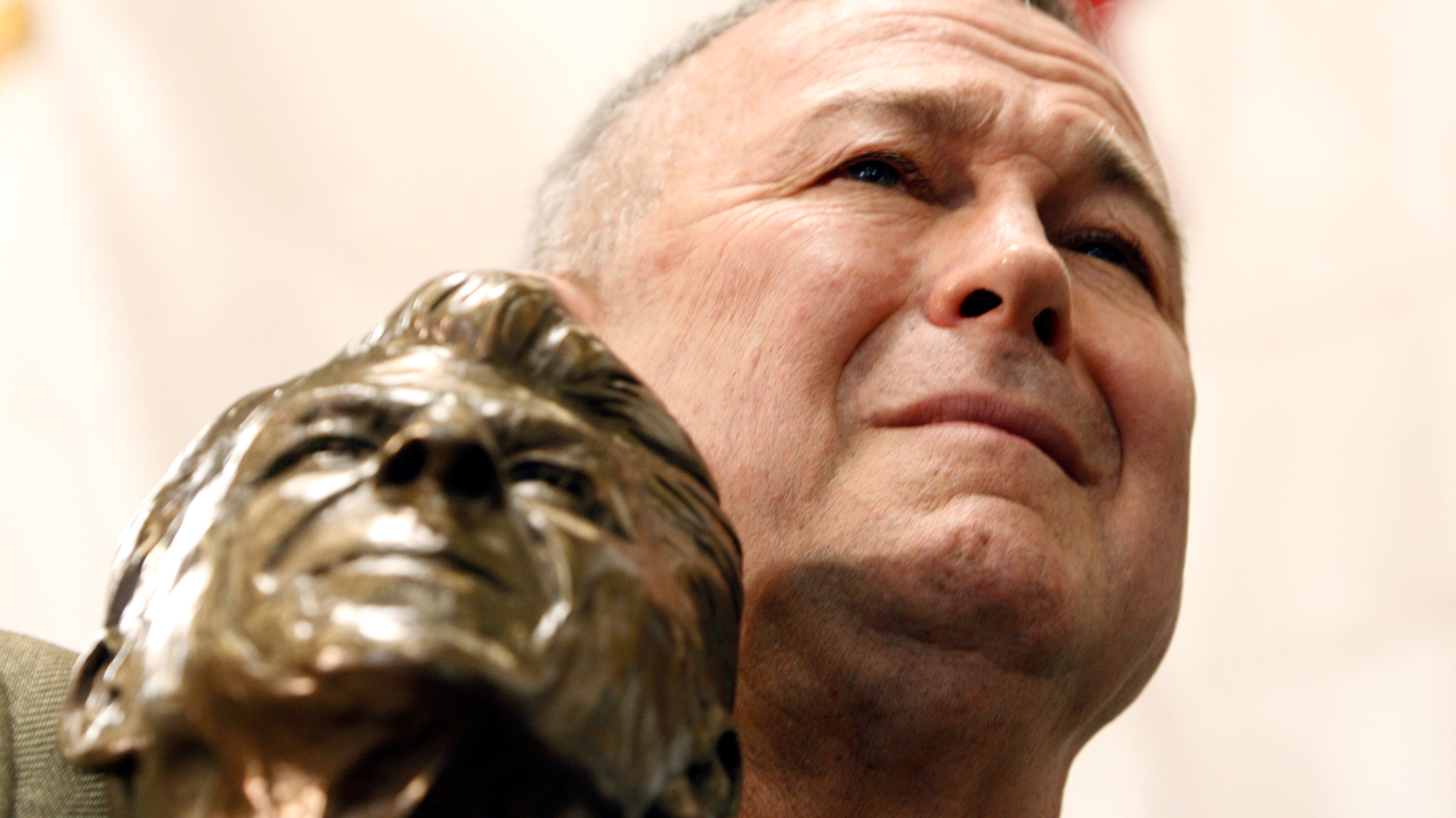 Rep. Dana Rohrabacher, R- Calif., holds a bust of Ronald Reagan as he listens to Republican presidential hopeful former Massachusetts Gov. Mitt Romney campaign at Bassett Furniture in Fountain Valley, Calif., Thursday, Jan. 31, 2008.