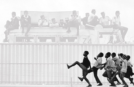 """An African American artist's """"remixing"""" of apartheid-era images raises appropriation questions"""