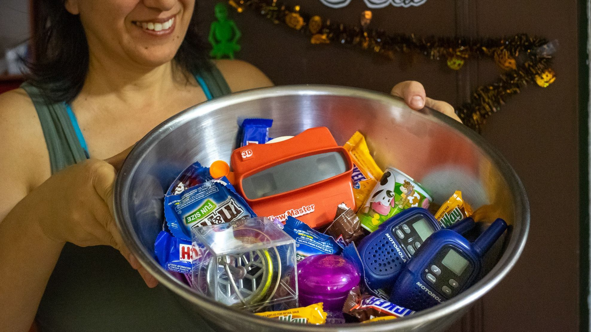 A large bowl of candy and toys