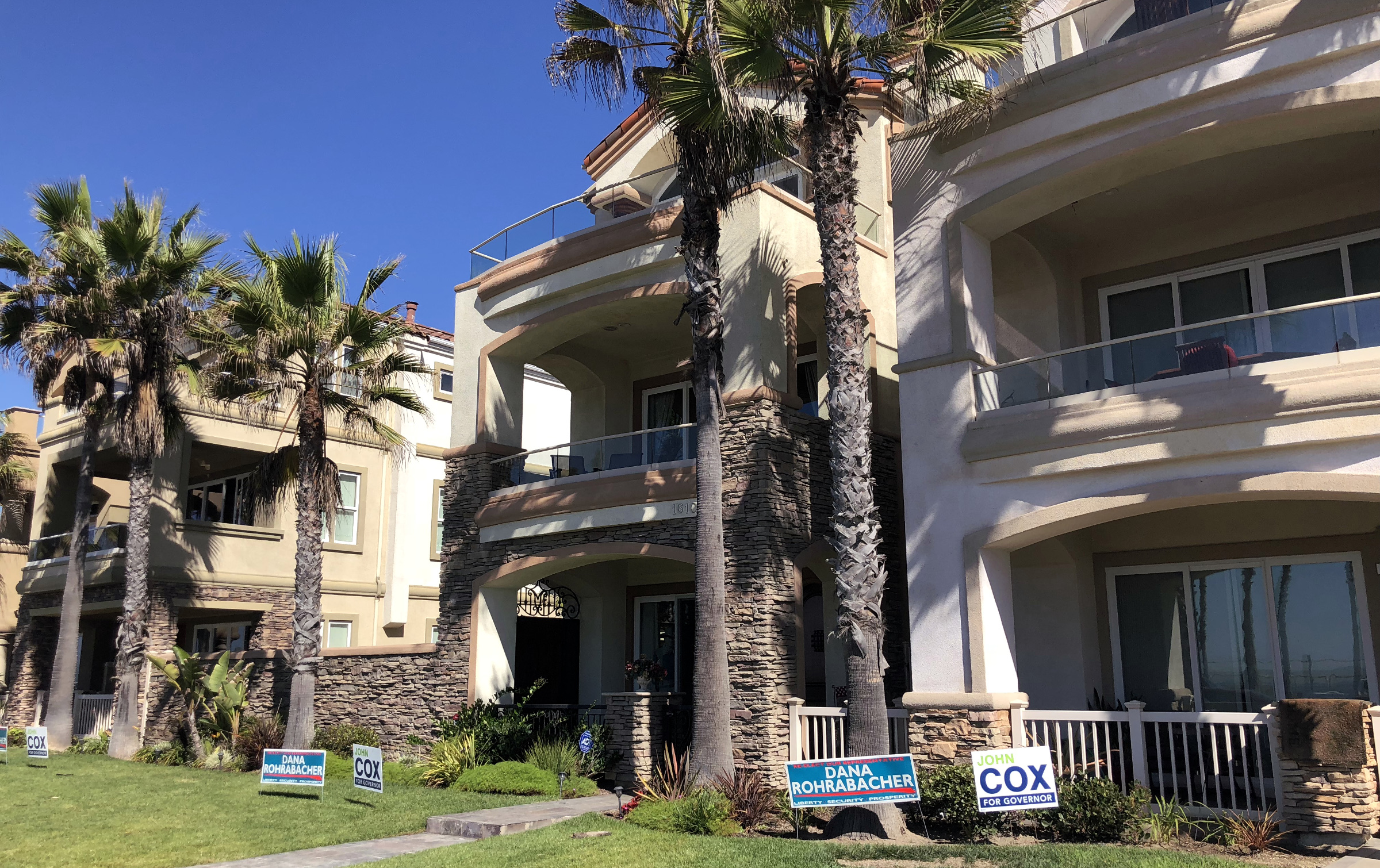 Beachfront homes host signs backing Rohrabacher.
