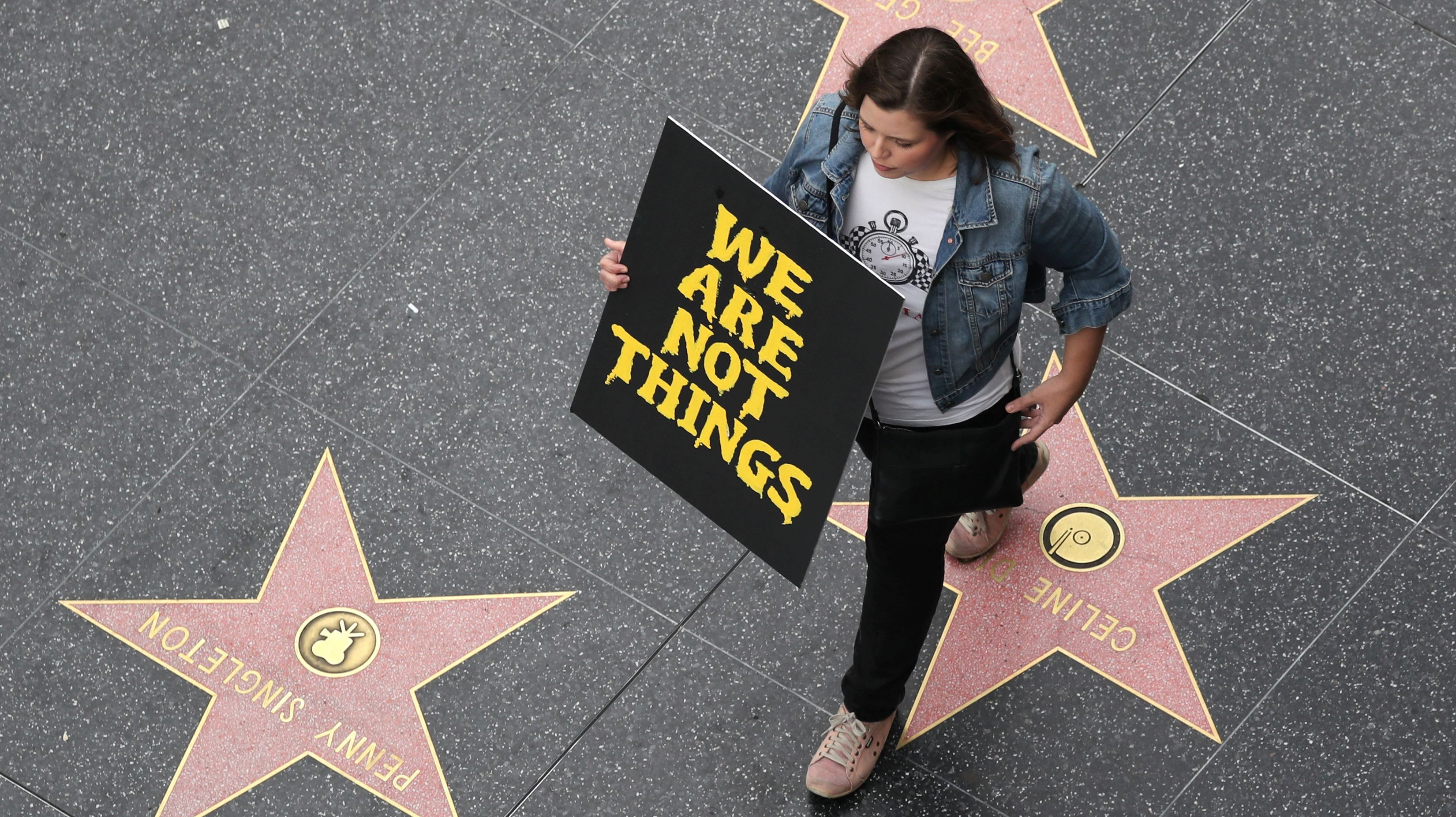 A demonstrator takes part in a #MeToo protest march for survivors of sexual assault and their supporters on the Hollywood Walk of Fame in Hollywood,