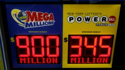 Signs with the Mega Millions and Powerball jackpots.