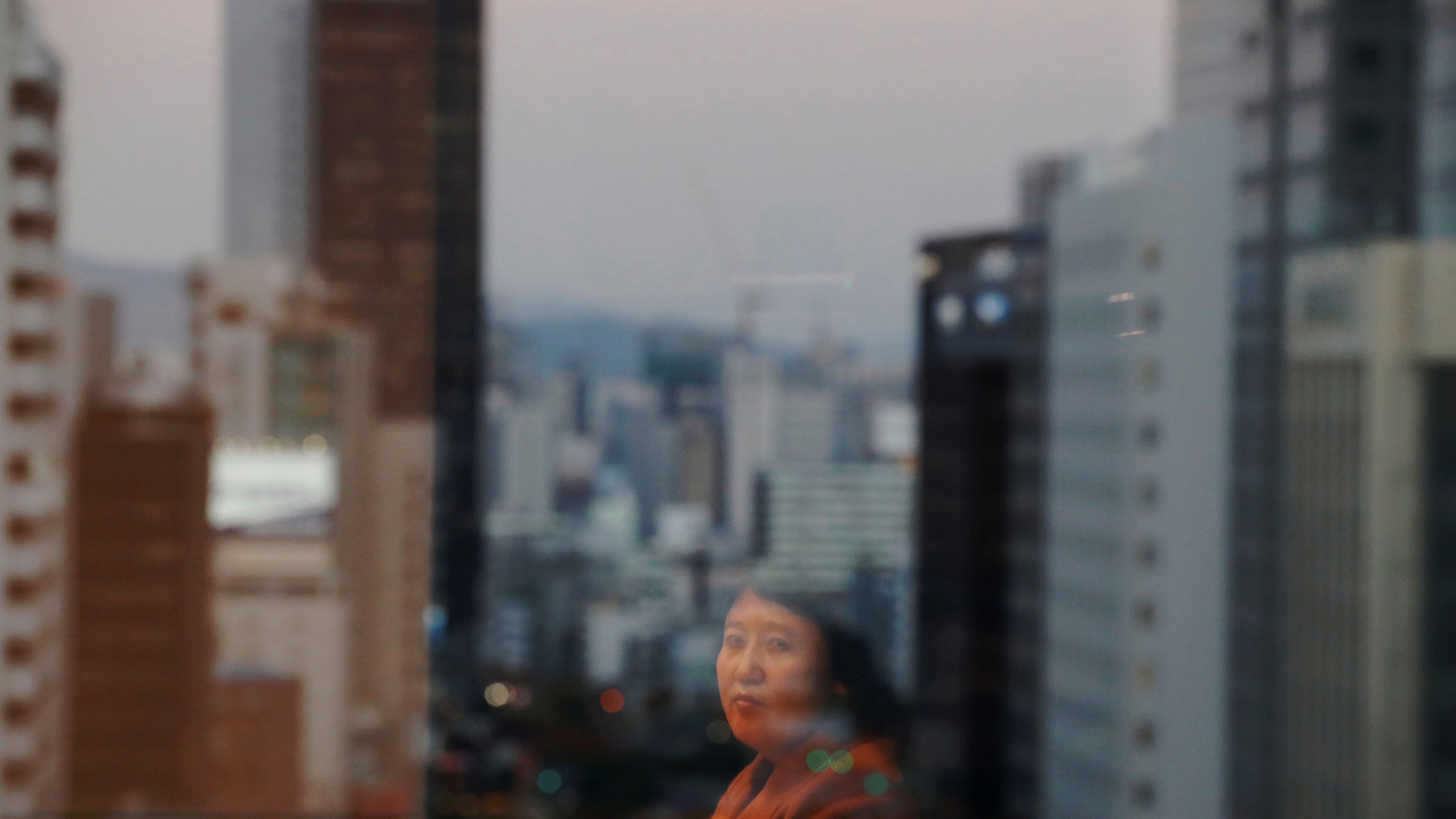 """A North Korean defector in Seoul. """"The thing I fear the most is finding out they've passed away before I have the chance to go back,"""" she said."""