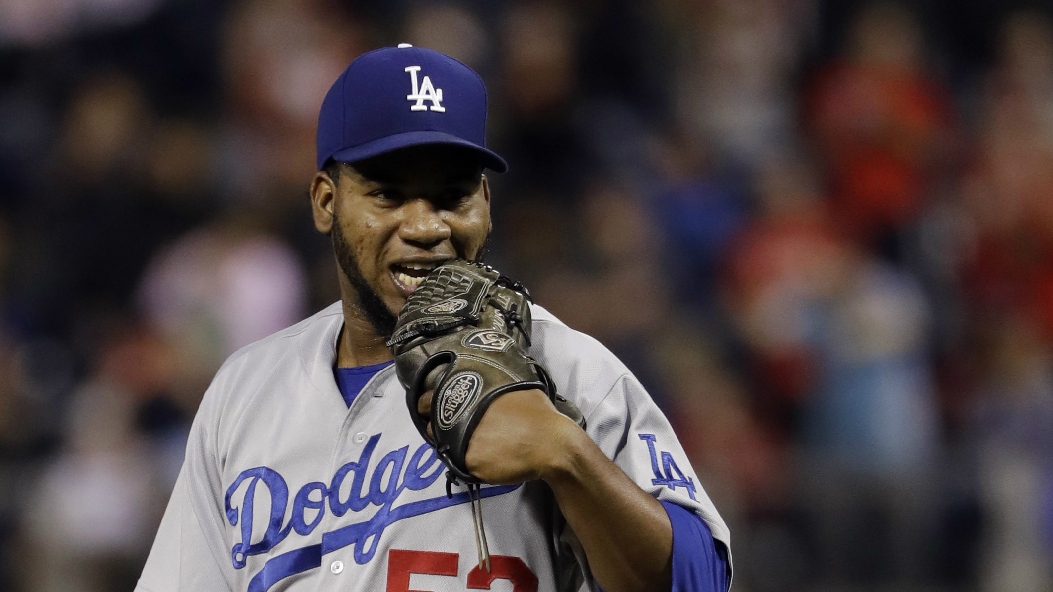 The pitcher Pedro Baez getting ready to pitch.