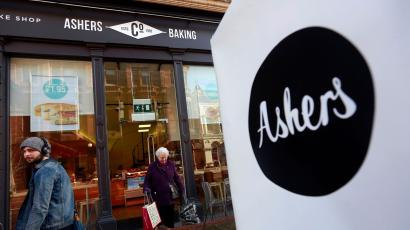 A woman leaves Ashers bakery in Belfast. March 26, 2015. Ashers is to face a discrimination case from the Equality Commission after it refused to make a cake bearing a pro-gay marriage slogan on it which was to be given to Andrew Muir, Northern Ireland's first openly gay mayor. The bakers refused to make the cake on the grounds that it contradicted their religious beliefs according to local media. REUTERS/Cathal McNaughton - LM1EB3Q0XKO01