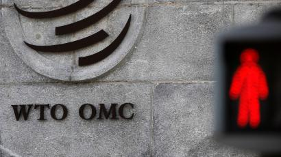 The logo of the World Trade Organization (WTO) at its headquarters next to a red traffic light in Geneva, Switzerland