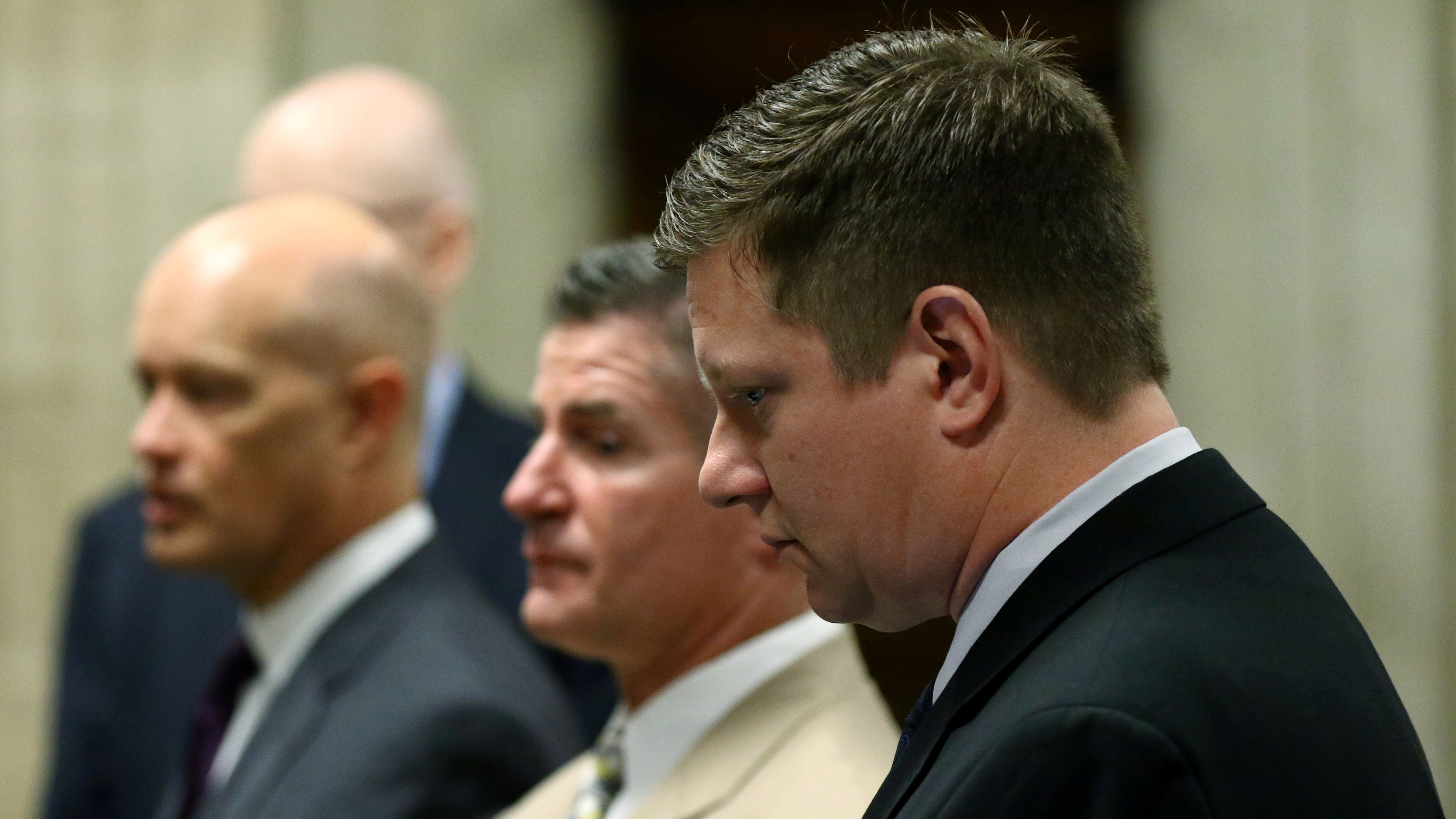 Chicago police Officer Jason Van Dyke stands with his attorneys during his murder trial.