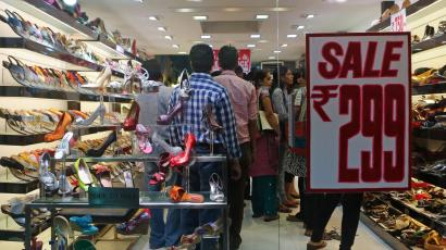 8a650e440fb People shop inside a shoe store on a street in Mumbai