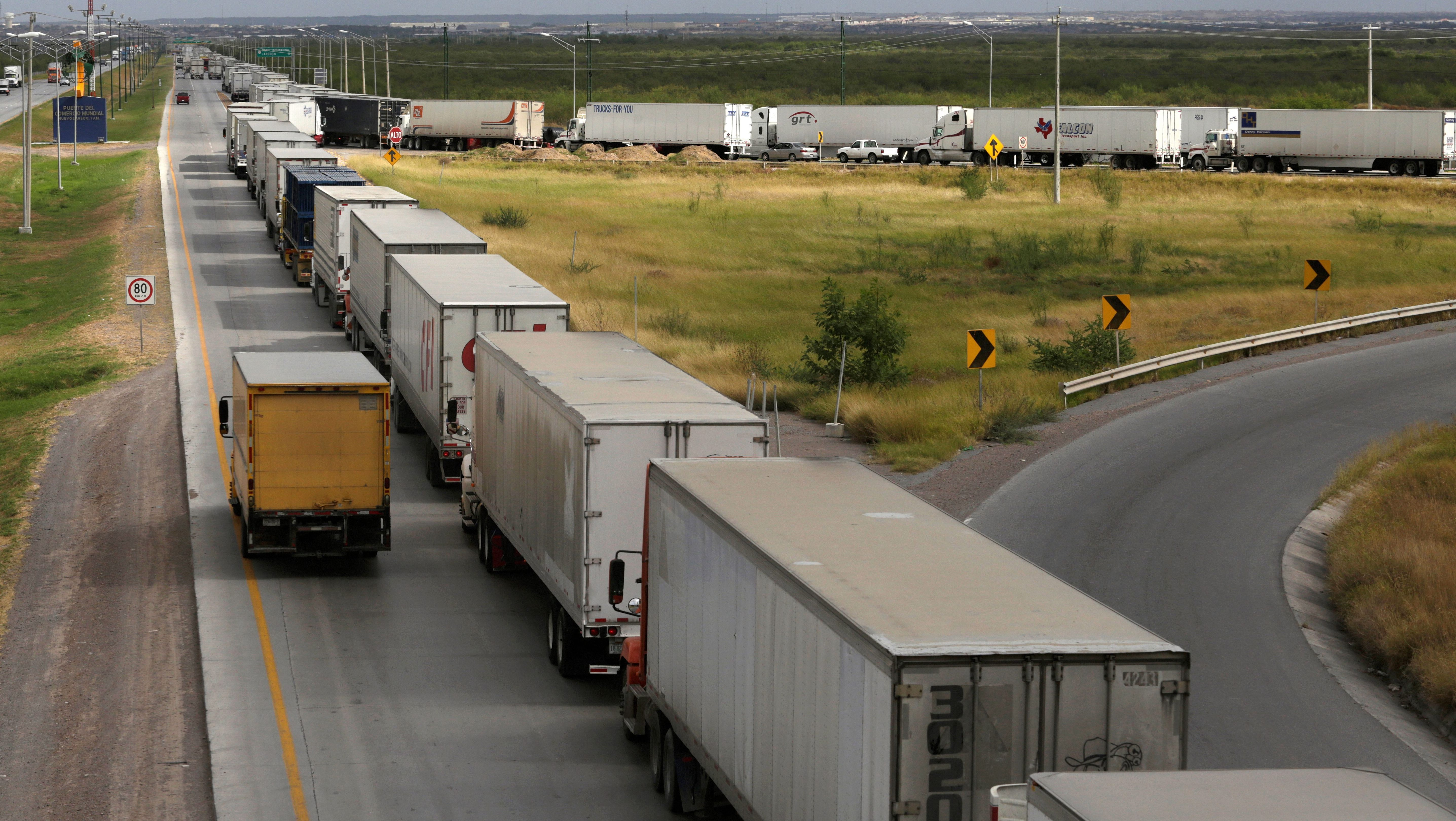 Trucks wait in a long queue for border customs control to cross into U.S. at the World Trade Bridge in Nuevo Laredo, Mexico
