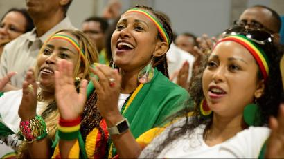 """Members of the Ethiopian diaspora, the largest outside of Ethiopia, cheer as they respond to remarks by Ethiopia's Prime Minister Abiy Ahmed, calling on them to return, invest and support their native land with the theme """"Break The Wall Build The Bridge"""", in Washington, U.S., July 28, 2018."""
