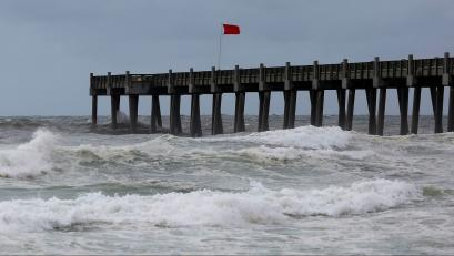 A red flag, warning of dangerous conditions, is seen on a pier in advance of Hurricane Michael in Pensacola, Florida, U.S. October 9, 2018. REUTERS/Jonathan Bachman - RC1CC6D88040