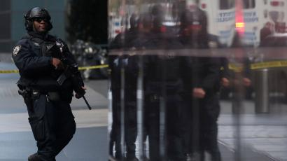 A member of the NYPD outside the Time Warner Center after a suspicious package was found inside CNN headquarters, October 24, 2018.