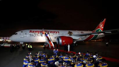 A police band plays as a Kenyan Airways Boeing 787-8 Dreamliner is seen during a ceremony marking the first non-stop flight, direct to New York City from Nairobi at the Jomo Kenyatta international airport in Nairobi, Kenya October 28, 2018.