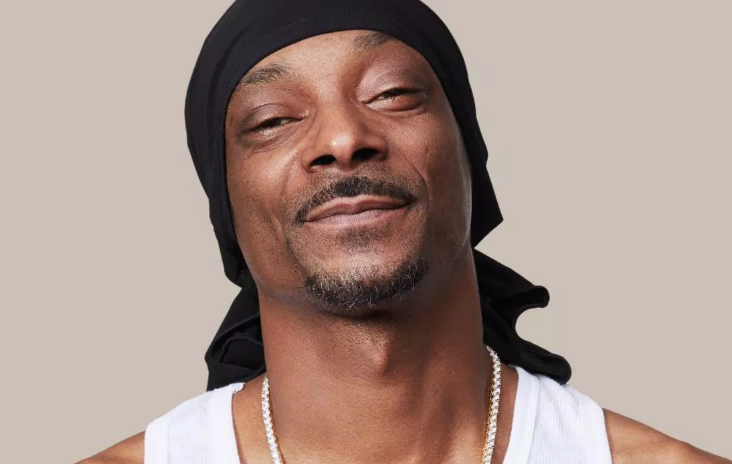 In Snoop Dogg's cookbook, he's a lifestyle guru like Martha Stewart