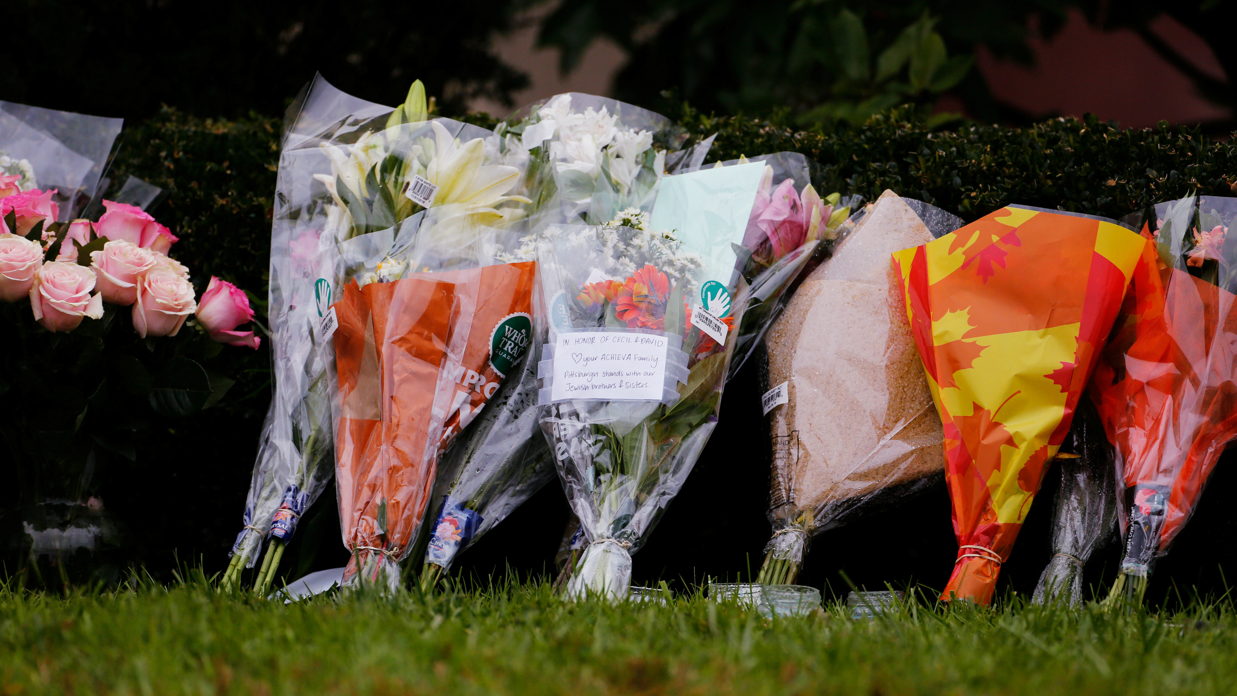 Flowers are placed an impromptu memorial at the Tree of Life synagogue following a shooting.