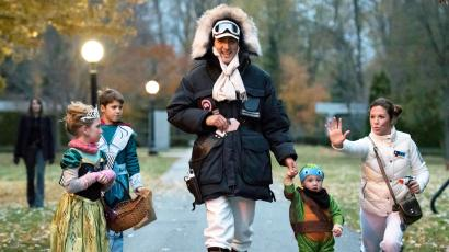Prime Minister-designate Trudeau, dressed as Han Solo, walks with his children as his wife.