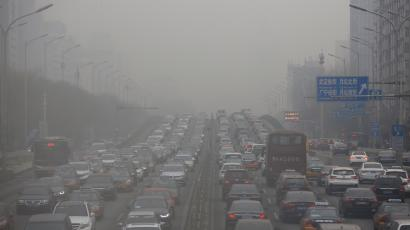Cars drive bumper to bumper on a congested highway on a polluted day in Beijing, China January 5, 2017.