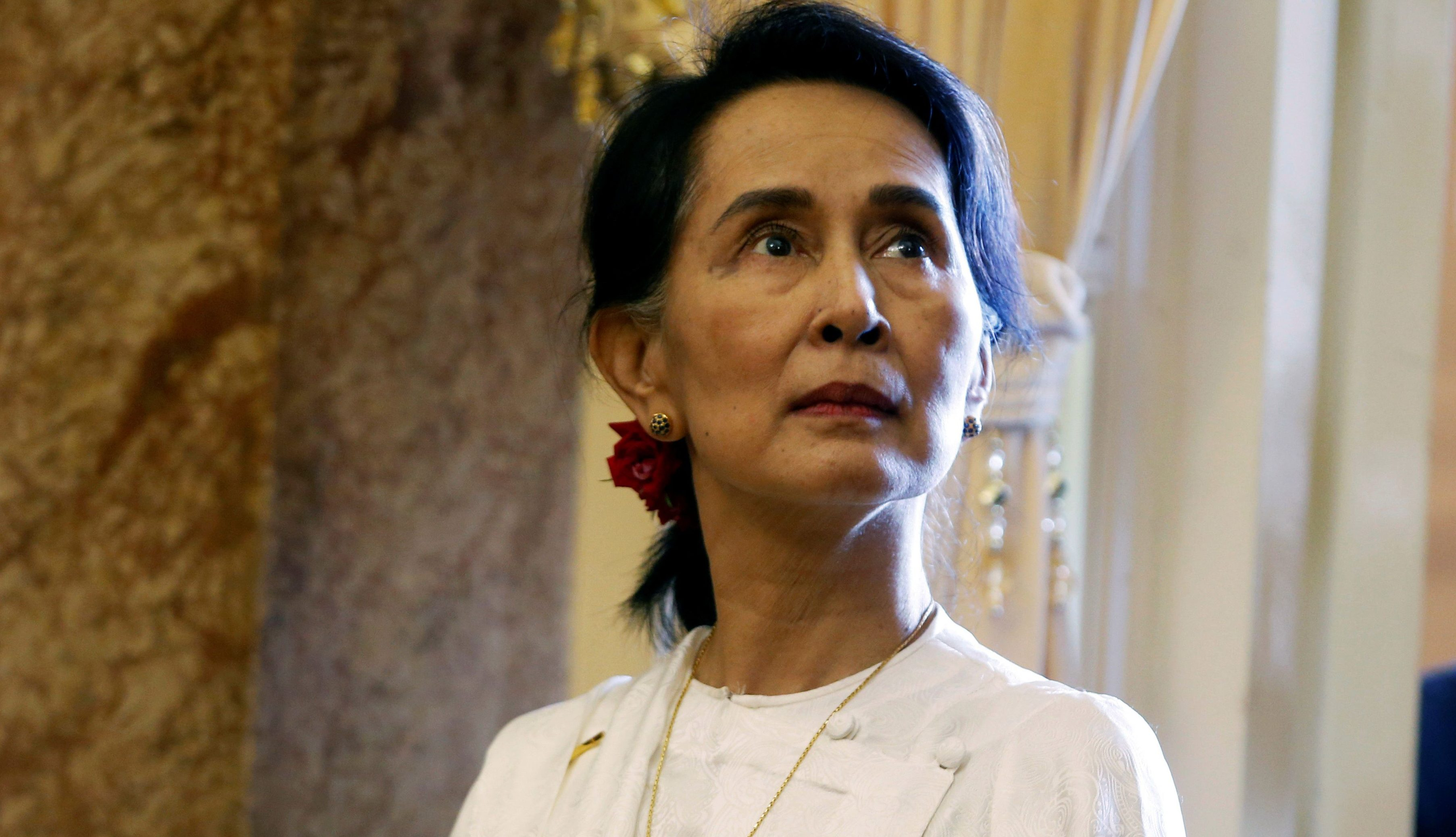 Myanmar's State Counsellor Aung San Suu Kyi is seen while she waits for a meeting with Vietnam's President Tran Dai Quang (not pictured) at the Presidential Palace during the World Economic Forum on ASEAN in Hanoi, Vietnam September 13, 2018. REUTERS/Kham/Pool - RC18BB447E10