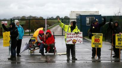 Protesters stand outside Cuadrilla's Preston New Road fracking site near Blackpool, Britain