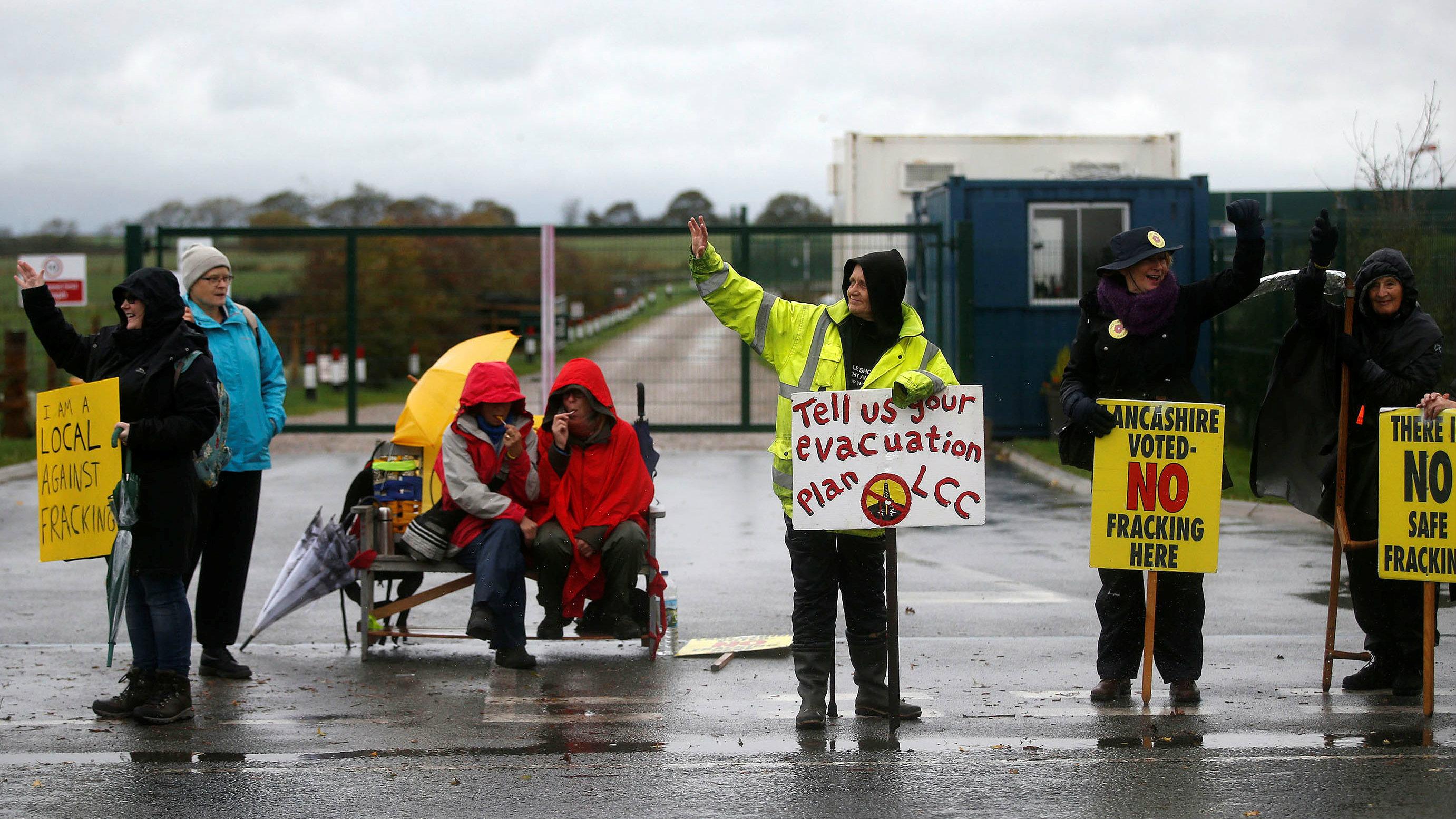 Protesters stand outside Cuadrilla's Preston New Road fracking site near Blackpool, Britain