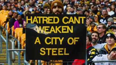 Posters honor the victims of the shooting at the Tree of Life Synagogue at a Pittsburgh Steelers game.