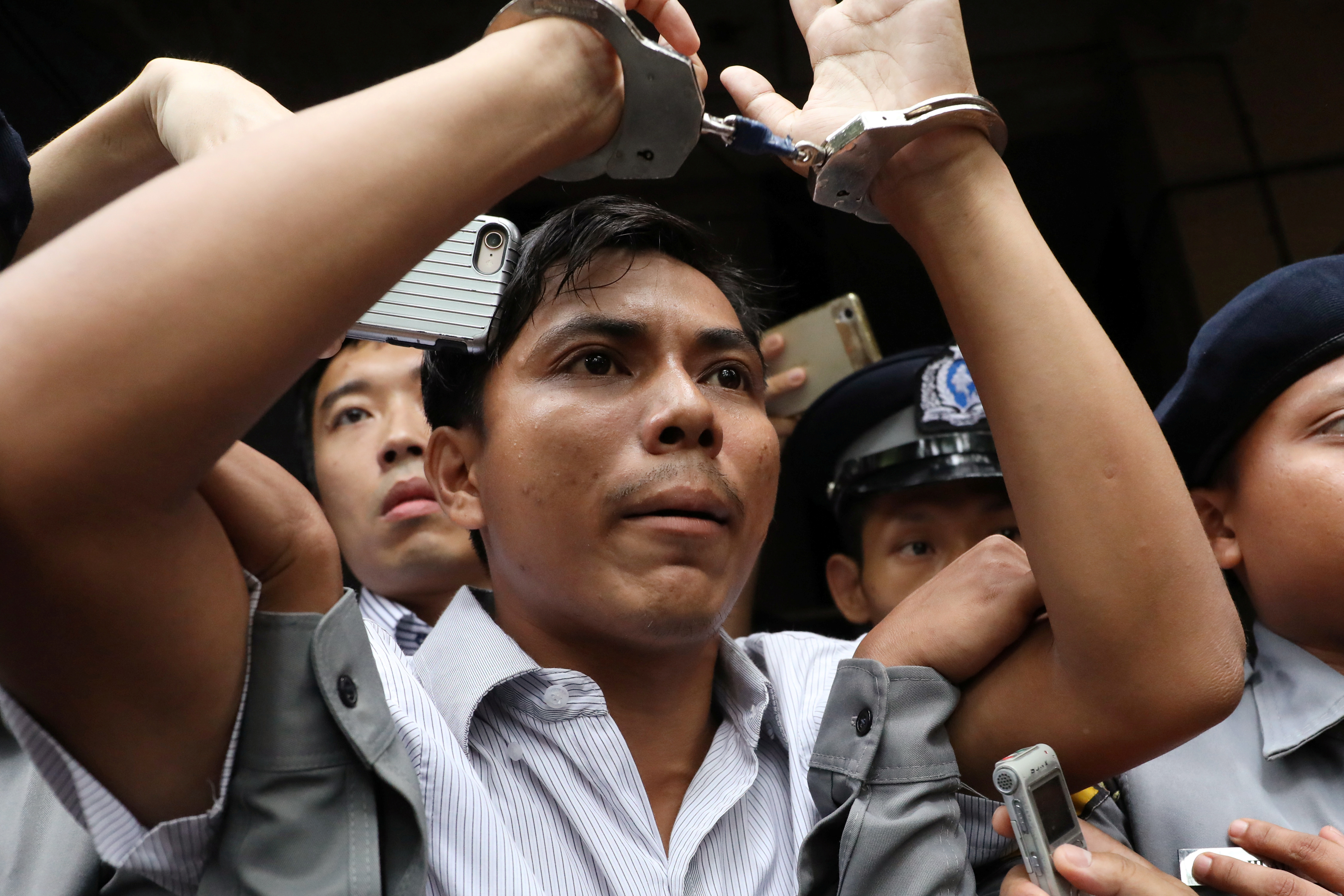 Reuters journalists Kyaw Soe Oo leaves after listening to the verdict at Insein court in Yangon, Myanmar, September 3, 2018. REUTERS/Ann Wang - RC1AF6D4AA80
