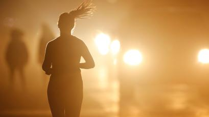 Silhouette of woman jogging.