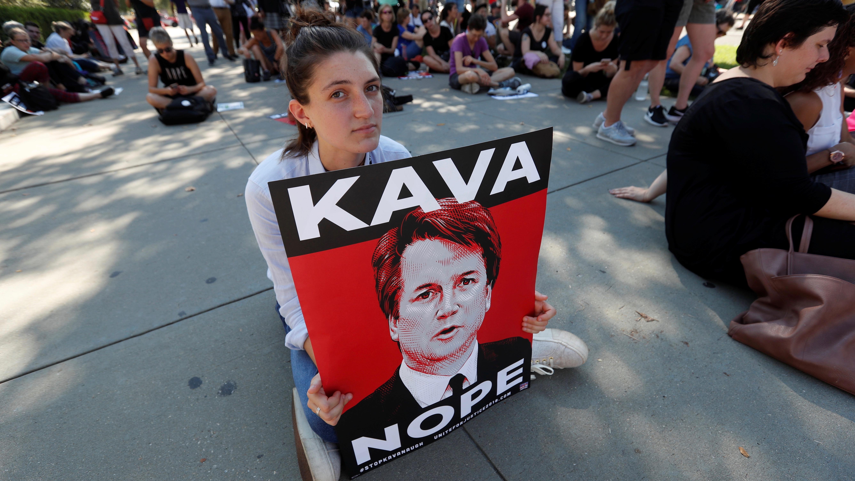A demonstrator holds a sign opposing Kavanaugh.