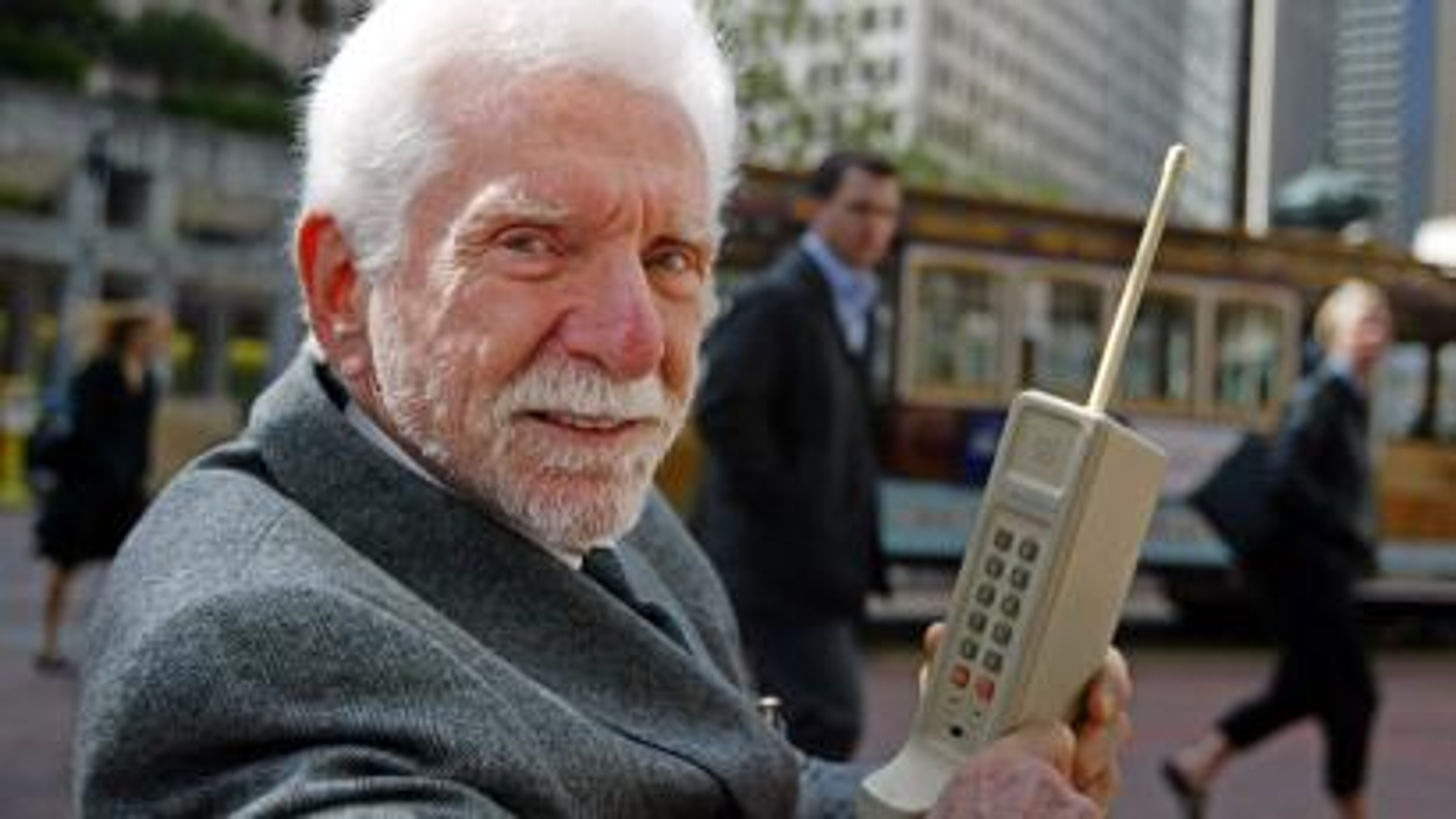 Martin Cooper holding Motorola DynaTAC